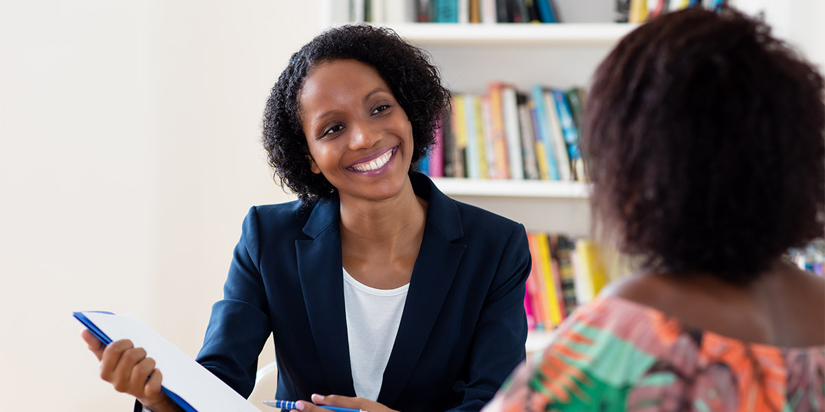 happy woman smiling in meeting with colleague