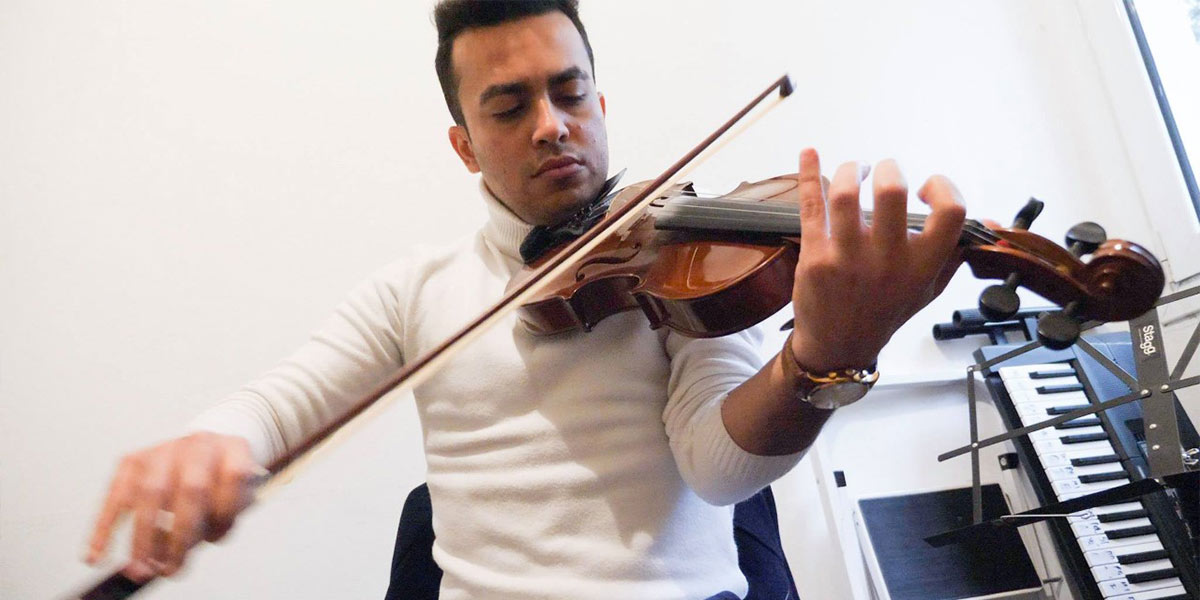 Refugee playing the violin