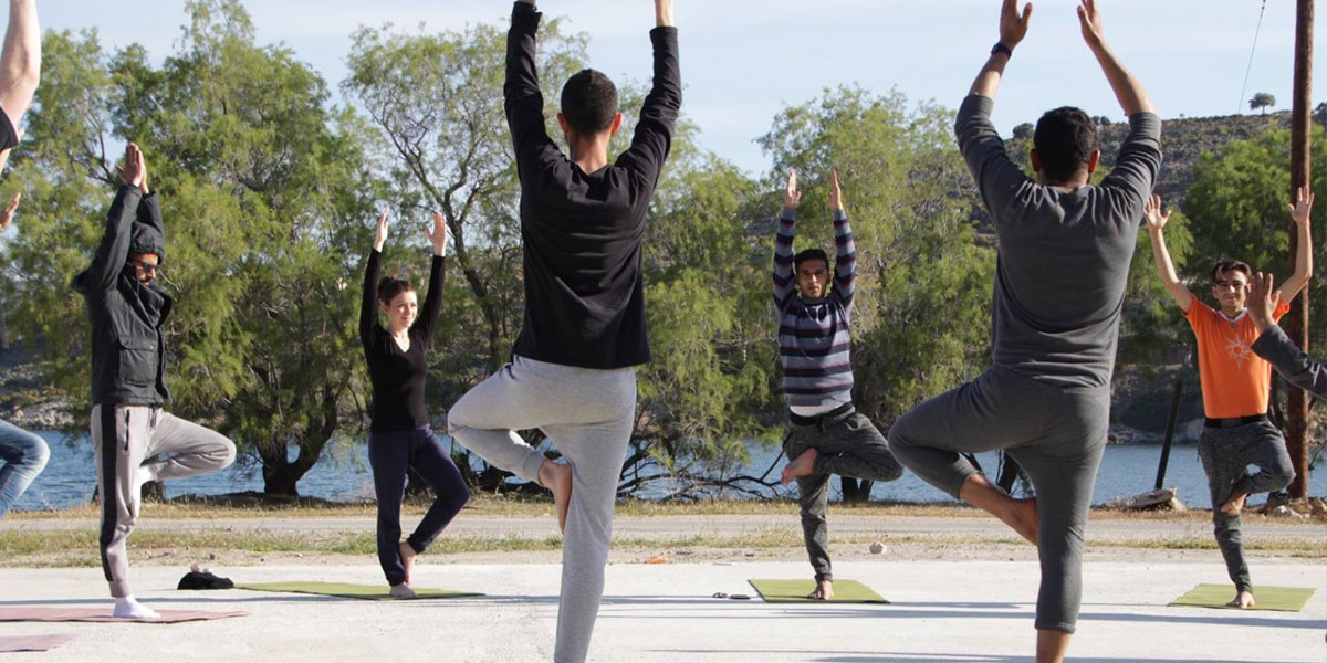 Group of people taking a yoga class outside